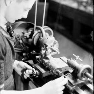 Student working at a lathe